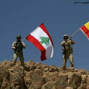 پرچم لبنان در كنار پرچم اسپانيا بعد از شکست تروریست ها