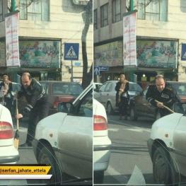 پلیس راهنمایی رانندگی خرده شیشه تصادف را شخصا جارو میکند